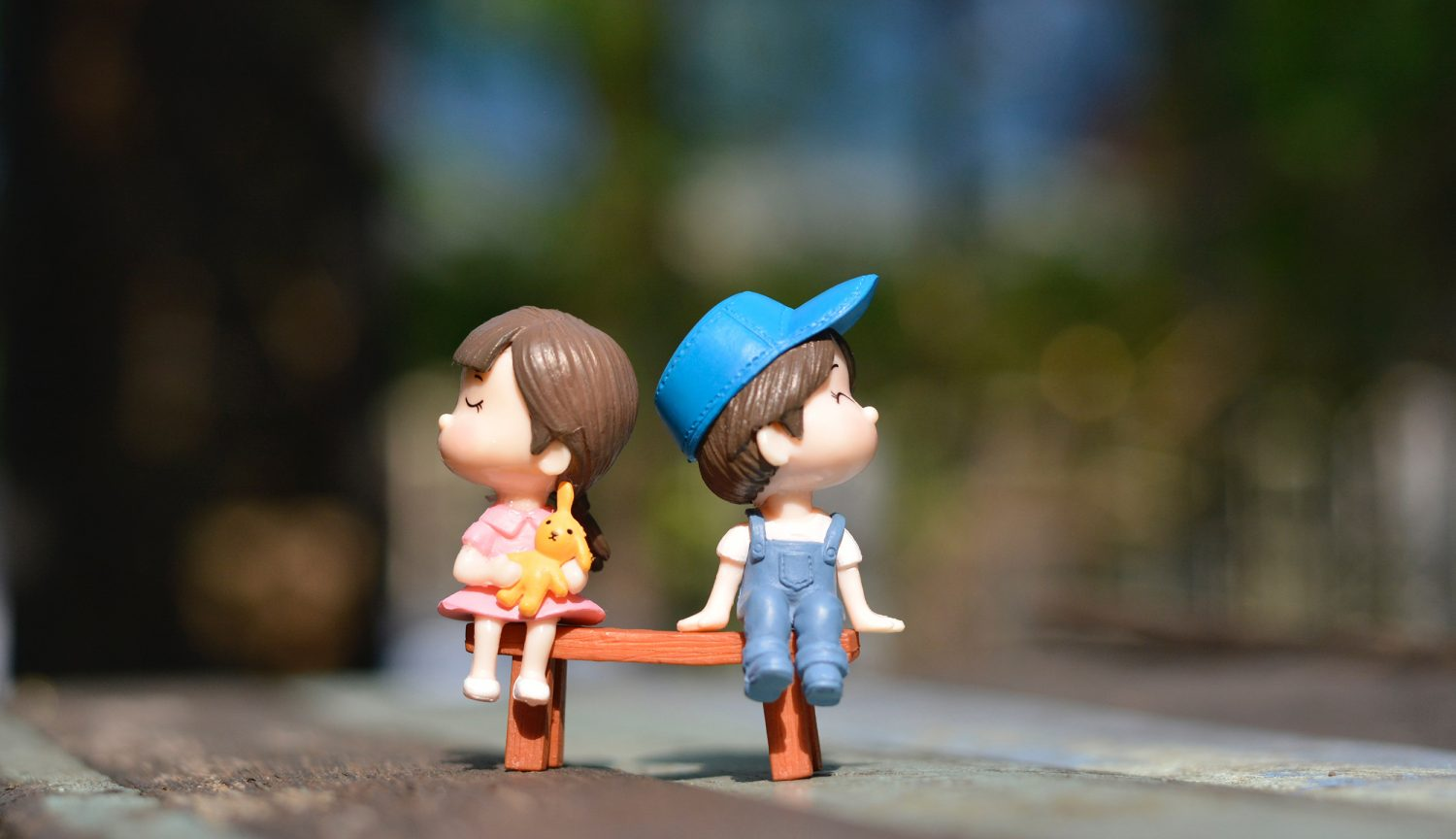 Adorable couple sitting on bench