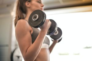 A picture containing person, indoor, weights, window