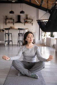 Woman sitting on floor with legs crossed
