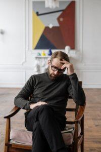 Man sitting down thinking