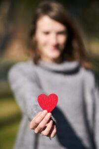 Female holding a red heart