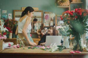 Two women working in a florist