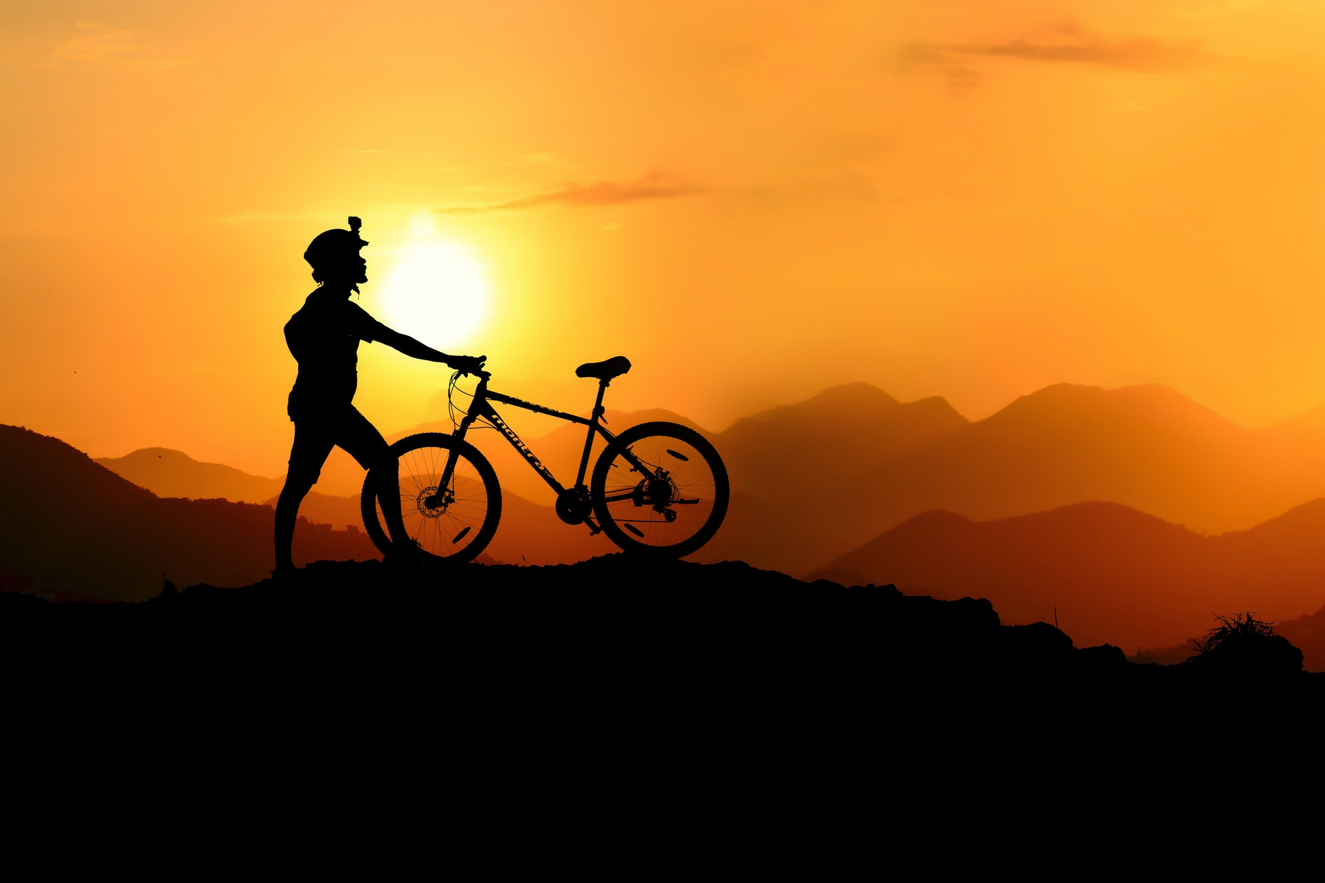 Bike rider on a hill at sunrise