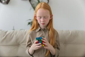 Young girl playing the rubix cube
