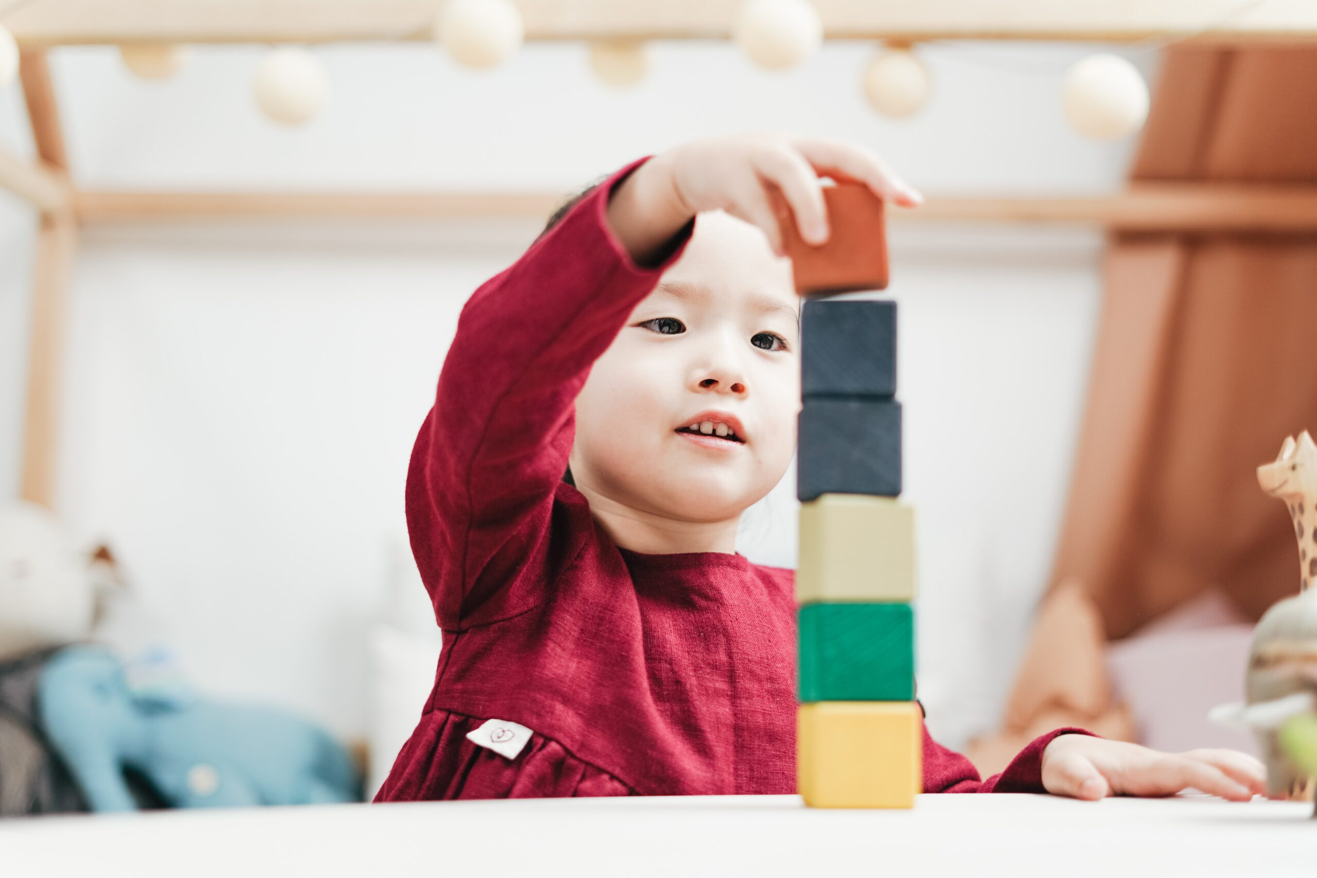 Young boy playing with block toys