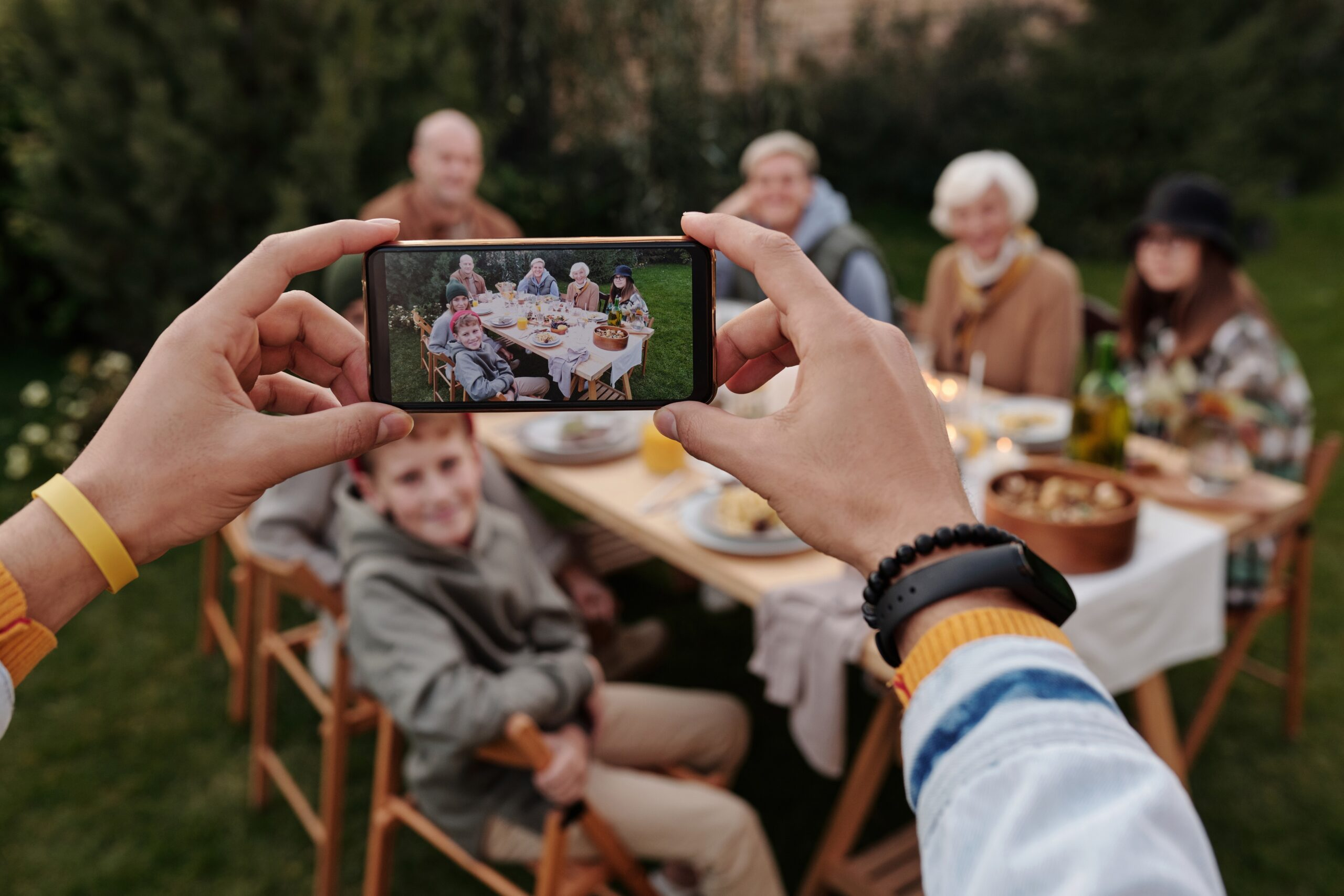 Someone taking a photo of family dinner