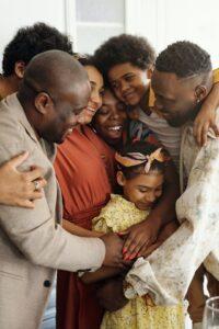 Multi-generational family hugging