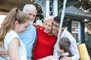 Multi-generational family laughing